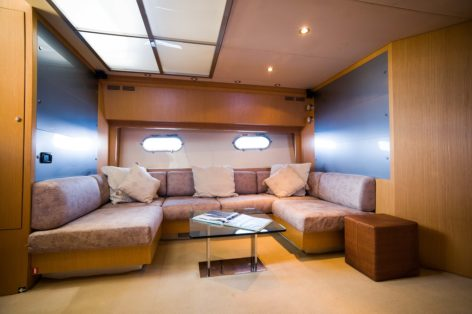 Living area in yacht for hire Riva 68 Ego
