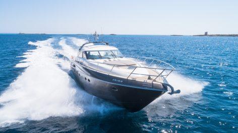 Princess V65 yacht sailing at top speed in Ibiza