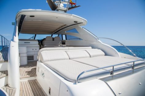 Spacious sunbeds on the stern deck on the luxury yacht Princess V58