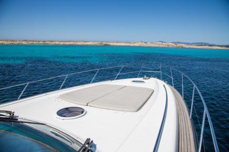 Sunbeds at the bow deck on the Princess V58 yacht Ibiza