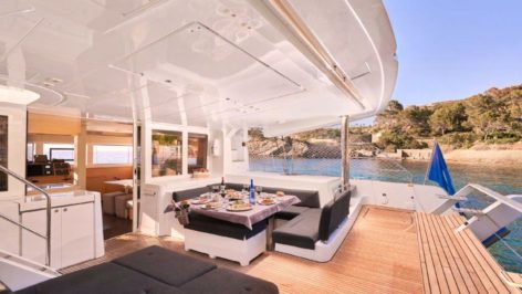 Teak wood and dining table on Lagoon 52 Ibiza