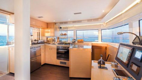 The kitchen is fully equipped on this luxurious catamaran for charter in Ibiza and Formentera