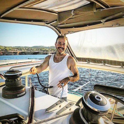 Jose Navas founder of Charteralia happy to sail on the Lagoon 400 catamaran