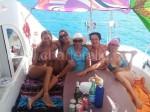 Festa flower power su barca Ibiza